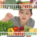 Woman Looking at Vegetables in Refrigerator